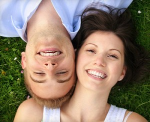 Smiling couple shows off their porcelain dental crowns near Grand Prairie TX.